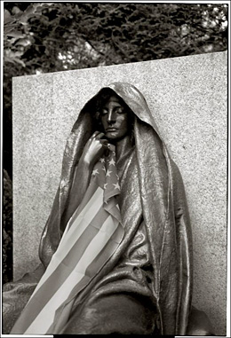 Mourning lady sculpture with flag